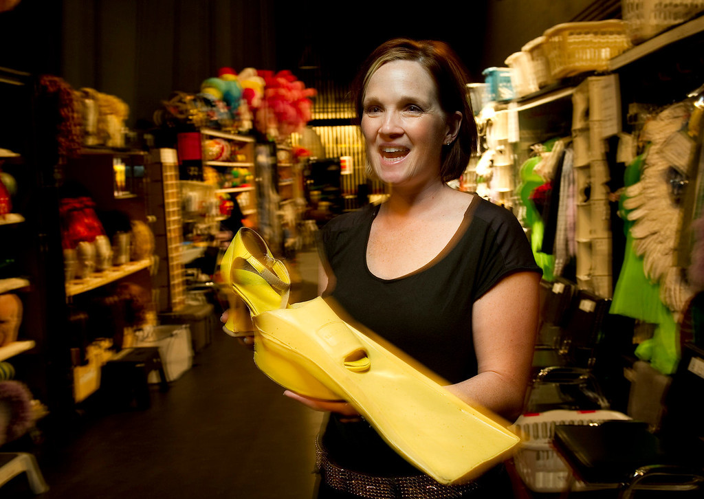 """. Wardrobe supervisor Gillian Austin holds the flipper shoes backstage at the Buell Theatre for the colorful production of \""""Priscilla Queen of the Desert The Musical\"""" on Thursday September 5, 2013. There are over 500 Tony Award winning costumes.   (Photo By Cyrus McCrimmon/The Denver Post )"""