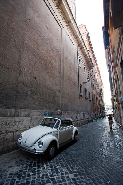 Volkswagen beetle on a narrow Roman street