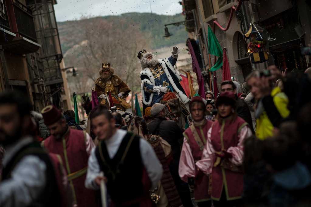 . The Cabalgata Los Reyes Magos (Cavalcade of the three kings) cross one street of the old city the day before Epiphany, in Pamplona, northern Spain, Tuesday, Jan. 5, 2016. It is a parade symbolizing the coming of the Magi to Bethlehem following the birth of Jesus. In Spain and many Latin American countries Epiphany is the day when gifts are exchanged. (AP Photo/Alvaro Barrientos)