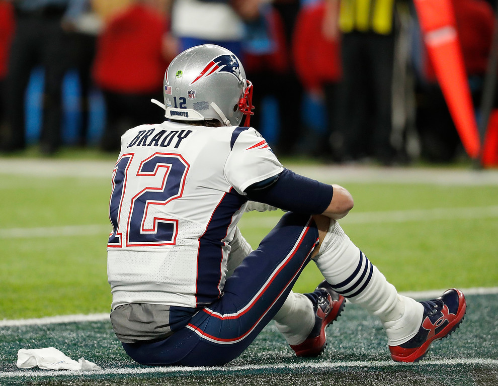 . New England Patriots\' Tom Brady sits on the field after the NFL Super Bowl 52 football game against the Philadelphia Eagles Sunday, Feb. 4, 2018, in Minneapolis. The Eagles won 41-33. (AP Photo/Charlie Neibergall)