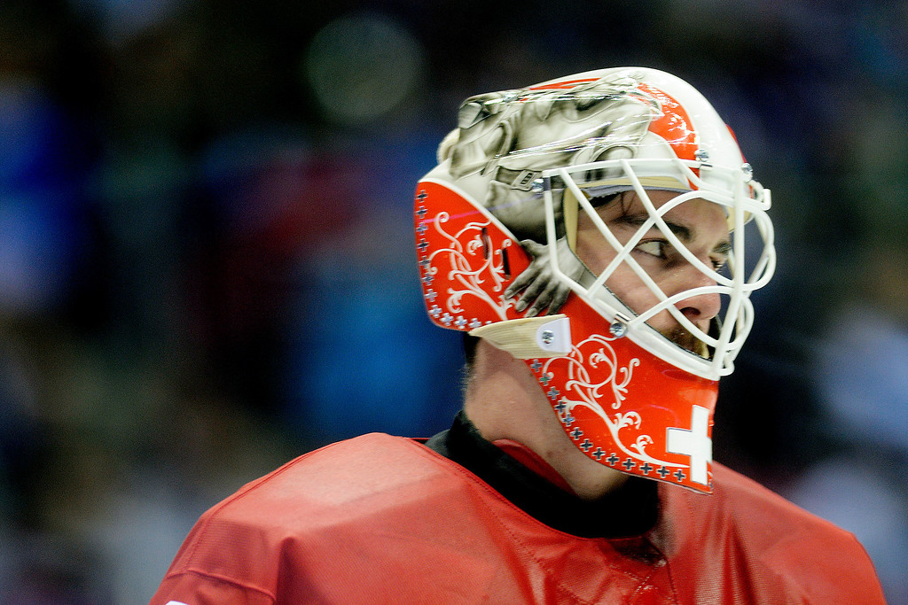 . Switzerland goalie Reto Berra takes a breather against Sweden during the action at Bolshoy Arena. Sochi 2014 Winter Olympics on Friday, February 14, 2014. (Photo by AAron Ontiveroz/The Denver Post)