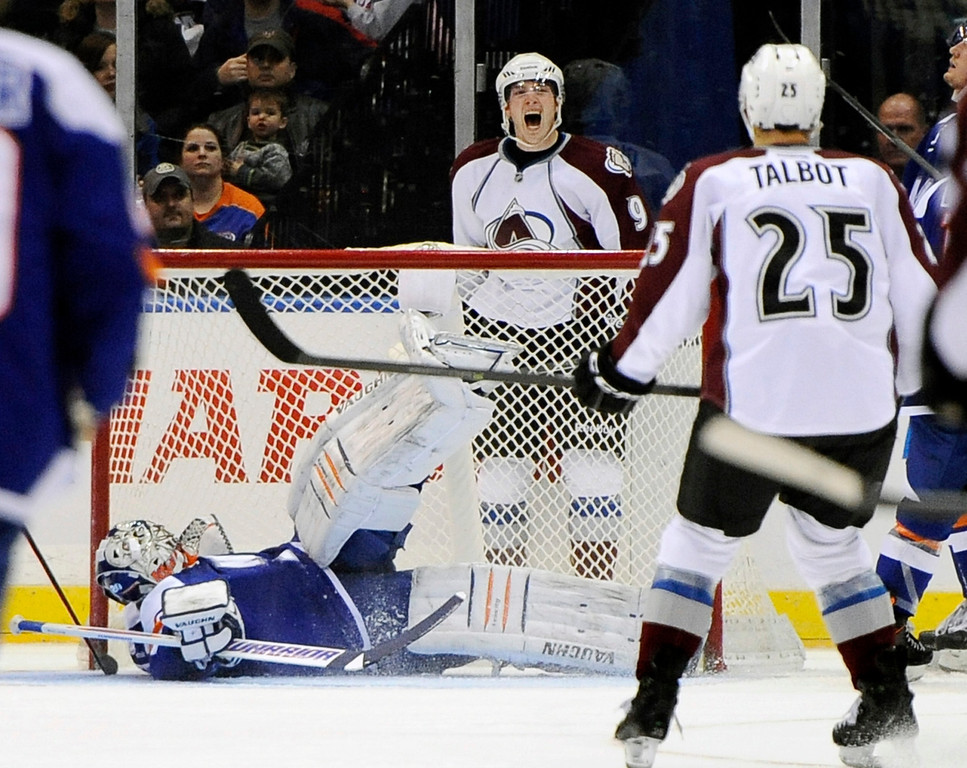 . New York Islanders goalie Evgeni Nabokov lays on the ice as Colorado Avalanche\'s Matt Duchene (9) celebrates his goal in the second period of an NHL hockey game on Saturday, Feb. 8, 2014, in Uniondale, N.Y. (AP Photo/Kathy Kmonicek)