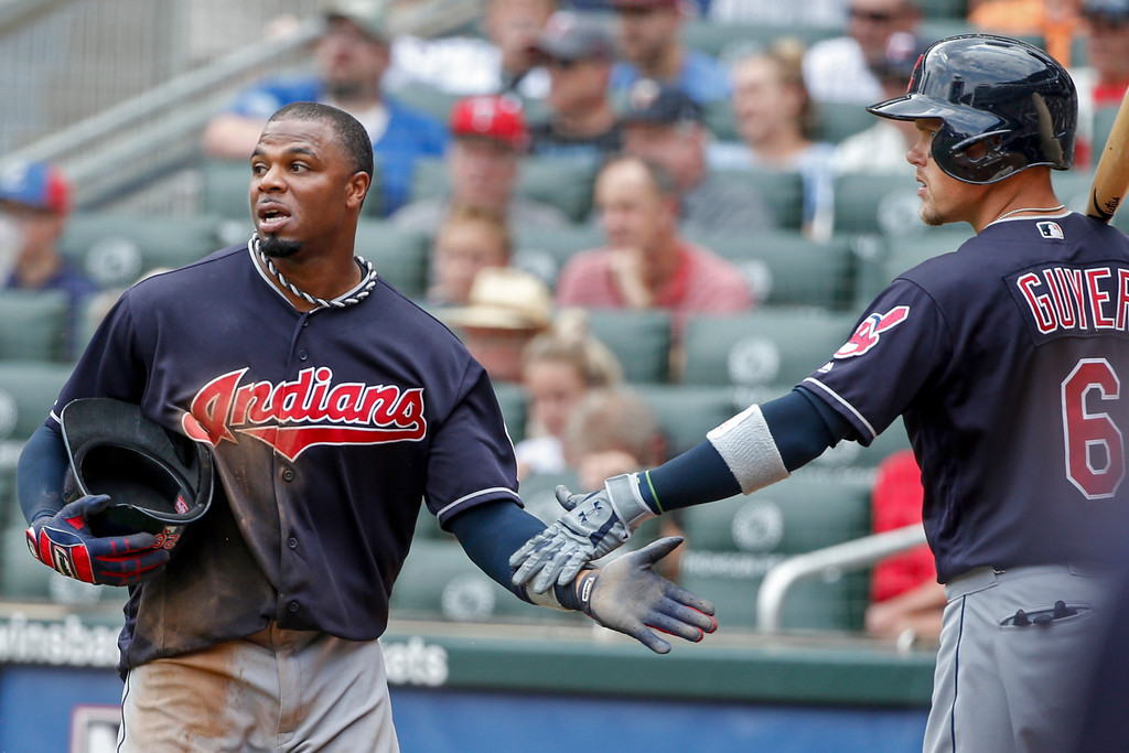 . Cleveland Indians Rajai Davis celebrates scoring with Brandon Guyer (6) against the Minnesota Twins in the sixth inning of a baseball game Wednesday, Aug. 1, 2018, in Minneapolis. (AP Photo/Bruce Kluckhohn)