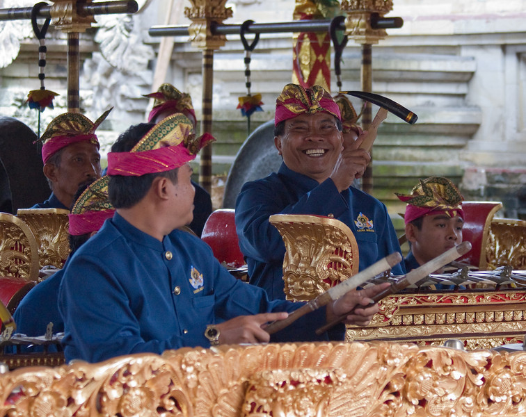 Having fun playing the Gamelan