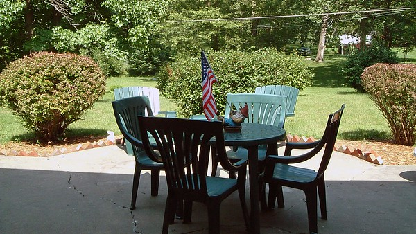 July 3, 2003:  The backyard patio furniture .  .  .