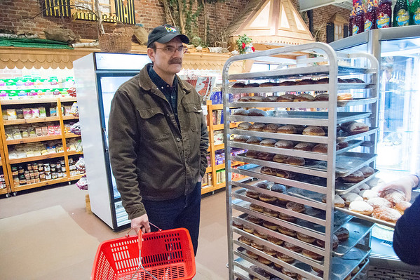 02/20/20 Wesley Bunnell | StaffrrMilczek Waldemer waits for his paczki while shopping at Roly Poly Bakery on Fat Thursday February 20, 2020.