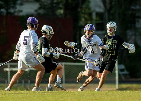 Broughton boys varsity lacrosse vs Enloe. March 10, 2020. D4S_7974