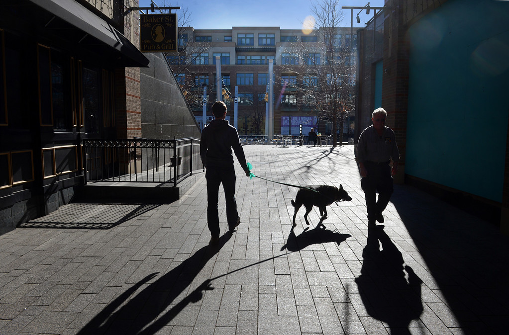 ". Mark Perna walks his dog Hannah on the plaza at Belmar in Lakewood, CO, January 22, 2013. Perna said he appreciates the accessibility, ""everything is close. I don\'t have to waste time getting the necessities.\"" (Photo By Craig F. Walker / The Denver Post)"