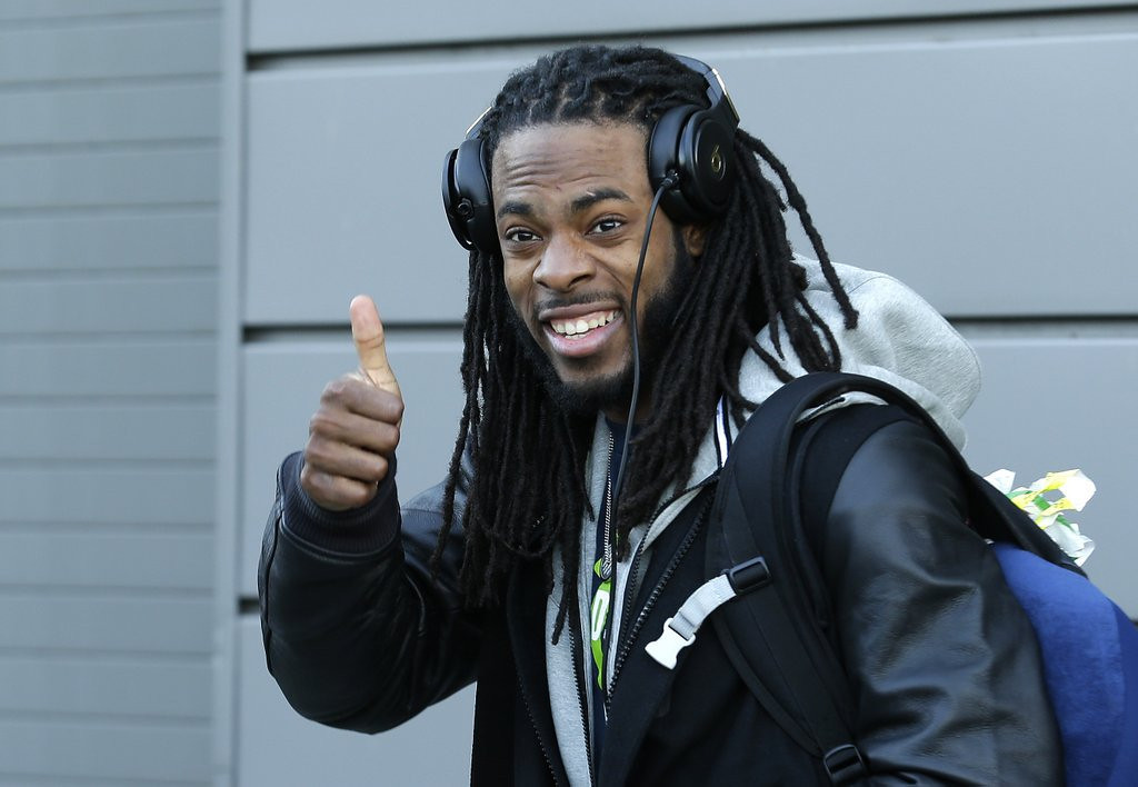 ". <p><b> Seattle cornerback Richard Sherman has become a household name since his NFC title game rant. As folks get to know more about it, they�re surprised to find out that he � </b> <p> A. Graduated from Stanford <p> B. Grew up on the hard streets of Compton <p> C. Is even more of a jerk in real life than on TV <p><b><a href=\'http://money.cnn.com/2014/01/24/news/companies/richard-sherman-rant/\' target=""_blank\"">HUH?</a></b> <p>   (AP Photo/Ted S. Warren)"