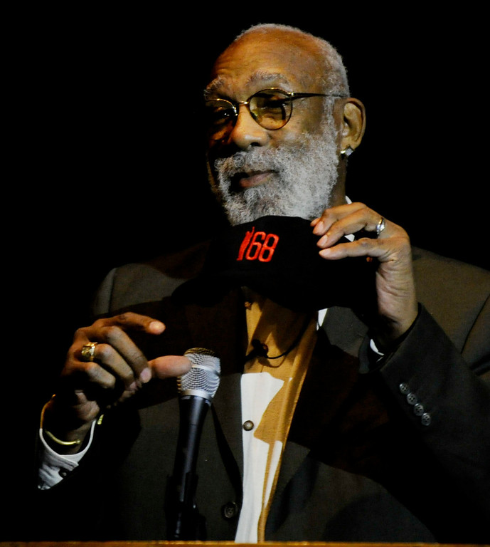 . Olympic bronze medalist John Carlos, who raised a fist in a controversial human rights salute in 1968, speaks at the Creative Arts Building on Martin Luther King Jr. Day in Pittsburg, Calif., on Monday, Jan. 21, 2013. Carlos points out the 68 representing 1968 and the figure of a person raising his fist that is on the hat he wore to the stage. He stressed to parents that they should be involved with the school system in their children\'s education. (Susan Tripp Pollard/Staff)