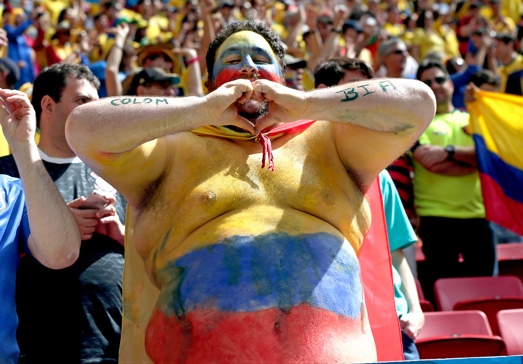 . A Colombian supporter gestures before the group C World Cup soccer match between Colombia and Ivory Coast at the Estadio Nacional in Brasilia, Brazil, Thursday, June 19, 2014.  (AP Photo/Marcio Jose Sanchez)