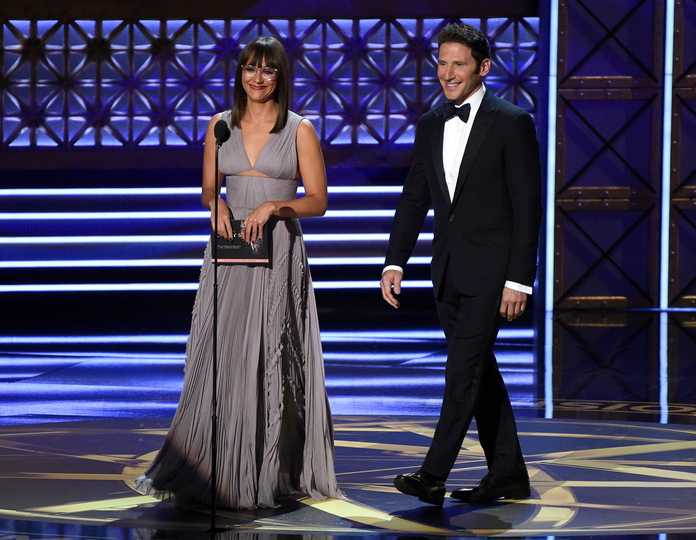 . Rashida Jones, left, and Mark Feuerstein present the award for outstanding directing for a drama series at the 69th Primetime Emmy Awards on Sunday, Sept. 17, 2017, at the Microsoft Theater in Los Angeles. (Photo by Chris Pizzello/Invision/AP)