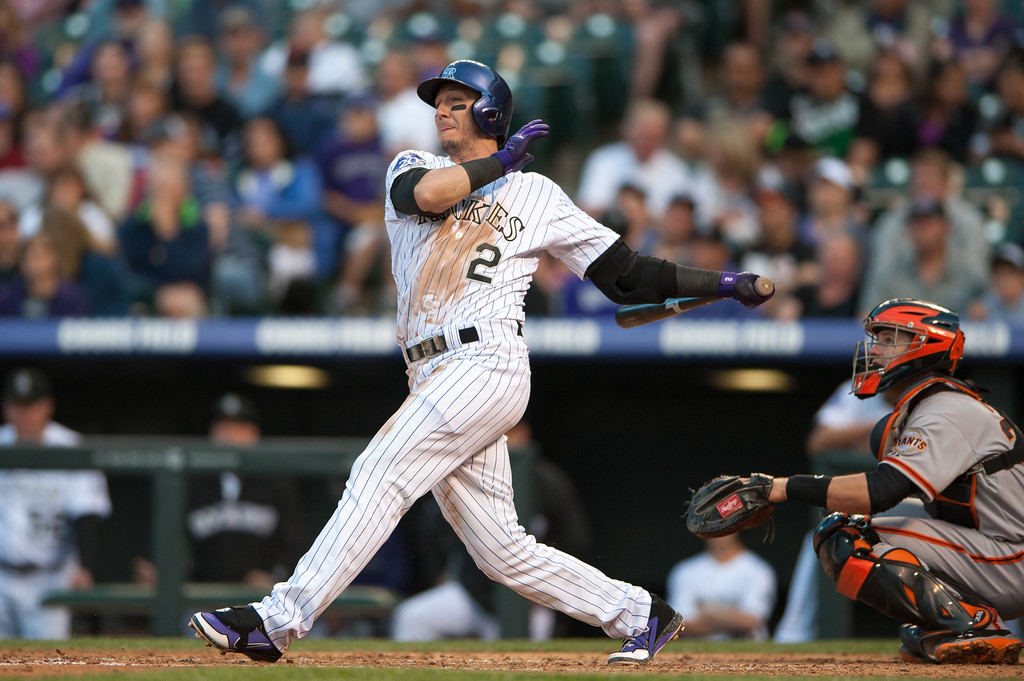 . DENVER, CO - MAY 18:  Troy Tulowitzki #2 of the Colorado Rockies hits a double in the third inning of a game against the San Francisco Giants at Coors Field on May 18, 2013 in Denver, Colorado. The Rockies led the Giants 4-1 after four innings.  (Photo by Dustin Bradford/Getty Images)