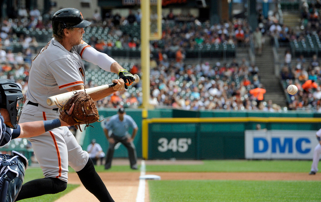 . San Francisco Giants� Hunter Pence hits a single against the Detroit Tigers in the first inning of a baseball game Saturday, Sept. 6, 2014, in Detroit.  The Giants won 5-4.  (AP Photo/Jose Juarez)