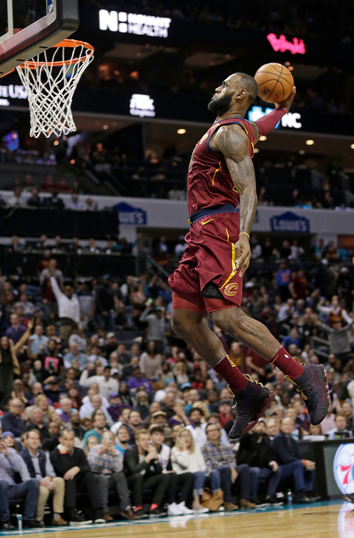 . Cleveland Cavaliers\' LeBron James goes up to dunk against the Charlotte Hornets during the second half of an NBA basketball game in Charlotte, N.C., Wednesday, Nov. 15, 2017. (AP Photo/Chuck Burton)