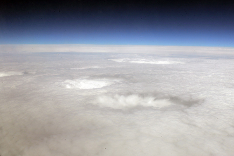 Very cool sink hole clouds over Oregon...I think.