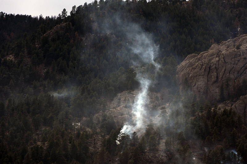 . A plume of smoke flares up inside the Galena Fire. Calmer weather conditions helped keep the Galena Fire west of Fort Collins in check today March 17th, 2013.  The fire stands at 45% containment but moisture is expected in the late afternoon which should help firefighters. (Photo By Helen H. Richardson/ The Denver Post)