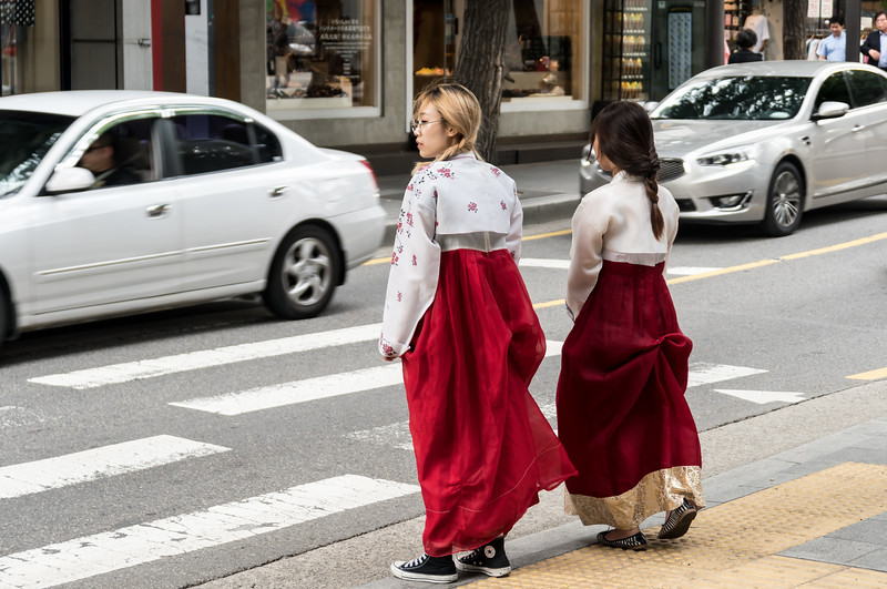 Two girls in Hanbok in a shopping area, Seoul