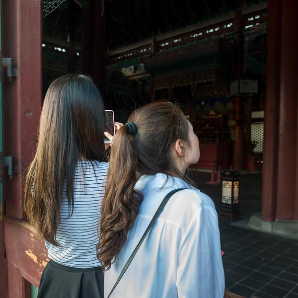 Women at Geunjeongjeon Building, Gyeongbokgung Palace, Seoul, South Korea
