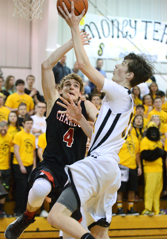 . Duncan Scott/DScott@News-Herald.com Riverside\'s goes in for a layup in the fourth quarter defended by Chardon\'s Zach Weiland. Riverside won Friday\'s PAC matchup 49-43 at the Riverside Community Field House.