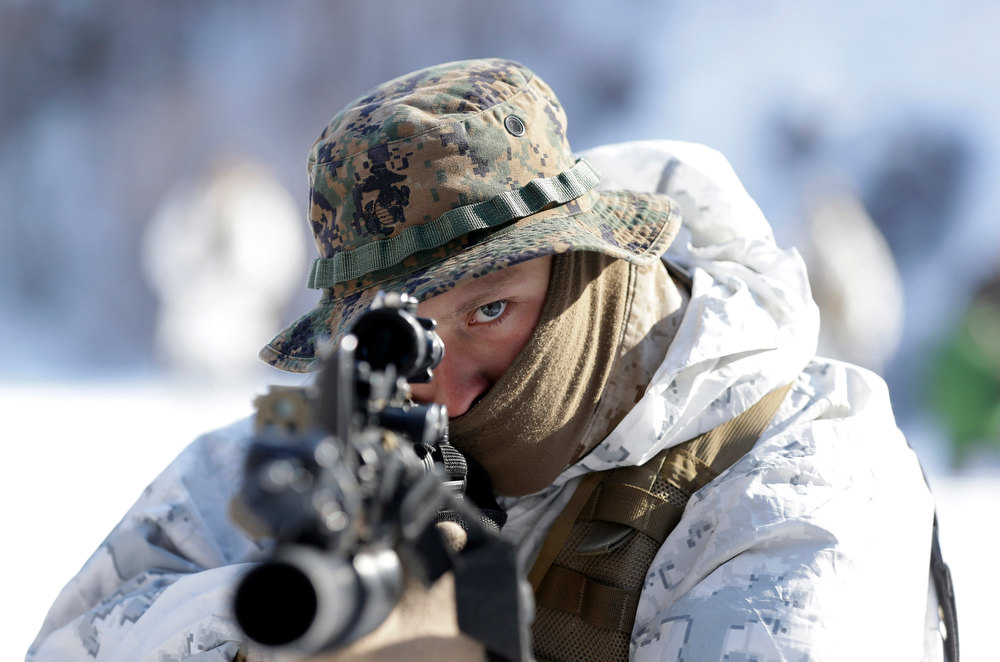 Description of . An unidentified U.S. Marine from 3-Marine Expeditionary Force 1st Battalion from Kaneho Bay, Hawaii, aims his gun during their joint military winter exercise with South Korean counterparts in Pyeongchang, east of Seoul, South Korea, Thursday, Feb. 7, 2013. More than 400 marines from the two countries participated in the Feb. 4-22 joint winter exercise held for the first time in South Korea. (AP Photo/Lee Jin-man)