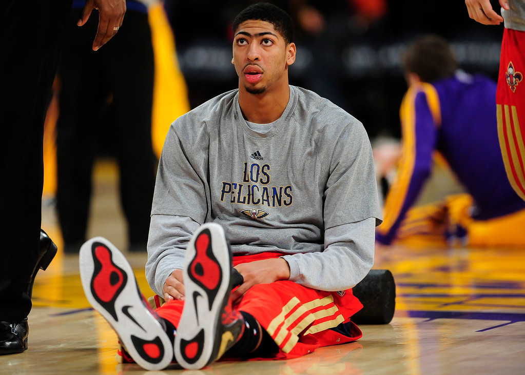 . New Orleans Pelicans forward Anthony Davis stretches out before the start an NBA basketball game against the Los Angeles Lakers, Tuesday, March 4, 2014, in Los Angeles.(AP Photo/Gus Ruelas)