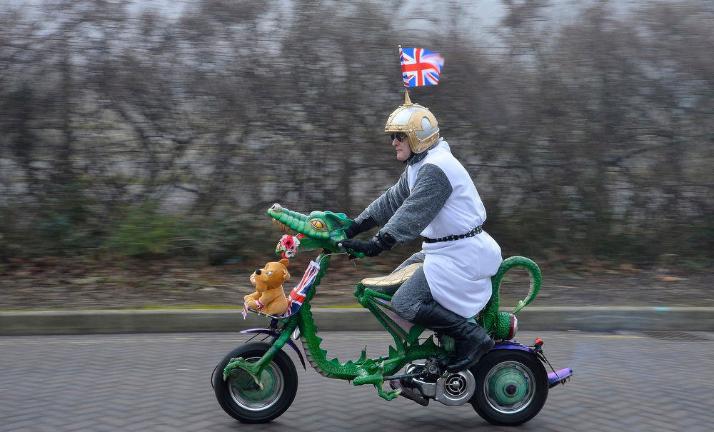 . Royal fan Ian Burrett arrives on a decorated motorbike for the visit by Britain\'s Catherine, Duchess of Cambridge to the National Fishing Heritage Centre in Grimsby, northern England March 5, 2013.      REUTERS/Toby Melville