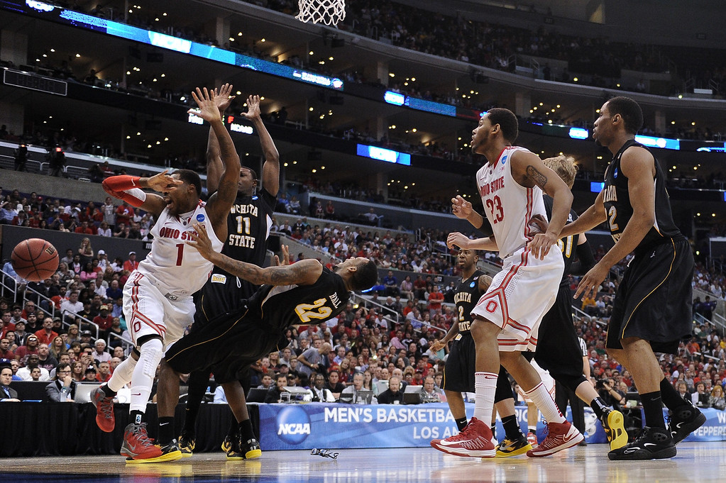 . Deshaun Thomas #1 of the Ohio State Buckeyes looses the ball against Carl Hall #22 of the Wichita State Shockers in the second half during the West Regional Final of the 2013 NCAA Men\'s Basketball Tournament at Staples Center on March 30, 2013 in Los Angeles, California.  (Photo by Harry How/Getty Images)