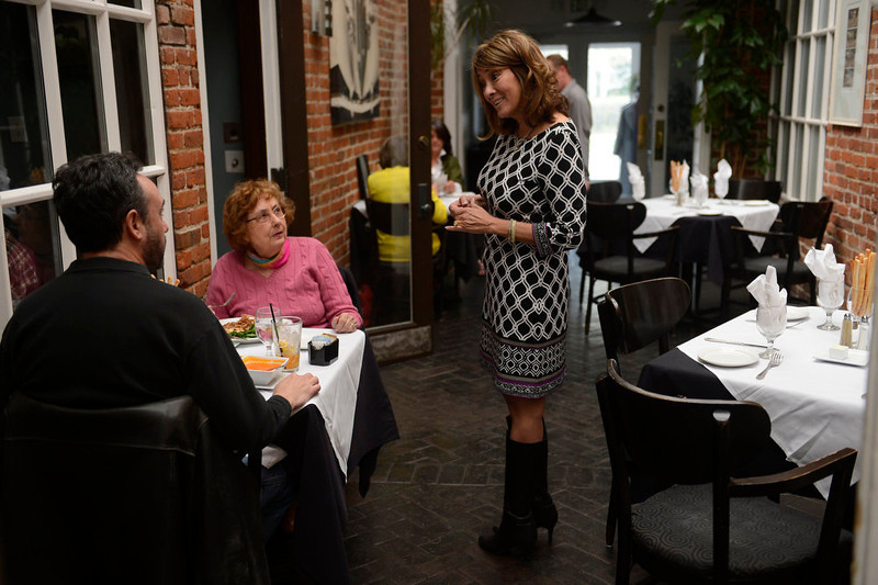 . Tammy Cunningham, owner of Strings Restaurant stops to chat with guests as she makes her way around the restaurant on the last day of service as the Denver favorite closes April 30, 2013 Denver, Colorado. (Photo By Joe Amon/The Denver Post)
