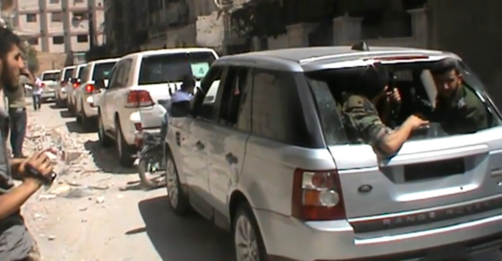 . An image grab taken from a video uploaded on YouTube by Harasta Media Centre on August 28, 2013 allegedly shows opposition fighters following a convoy of United Nations (UN) vehicles travelling to the site where rockets had fallen in Damascus\' eastern Ghouta suburb during an investigation into a suspected chemical weapons strike near the capital. Rebels who control the area said the inspectors had travelled in a six-vehicle convoy to the suburb of Eastern Ghouta, one of the areas hit in the August 21 attacks.  DSK/AFP/Getty Images