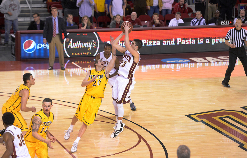 . aDenver Pioneers guard Brett Olson (23) hits the game winning shot over Wyoming Cowboys guard Nathan Sobey (20) with 03.7 second left in the second half December 15, 2013 Magness Arena. Denver Pioneers guard Brett Olson (23) was fouled on the play and resulted in a three point game with 03.7 left.  (Photo by John Leyba/The Denver Post)