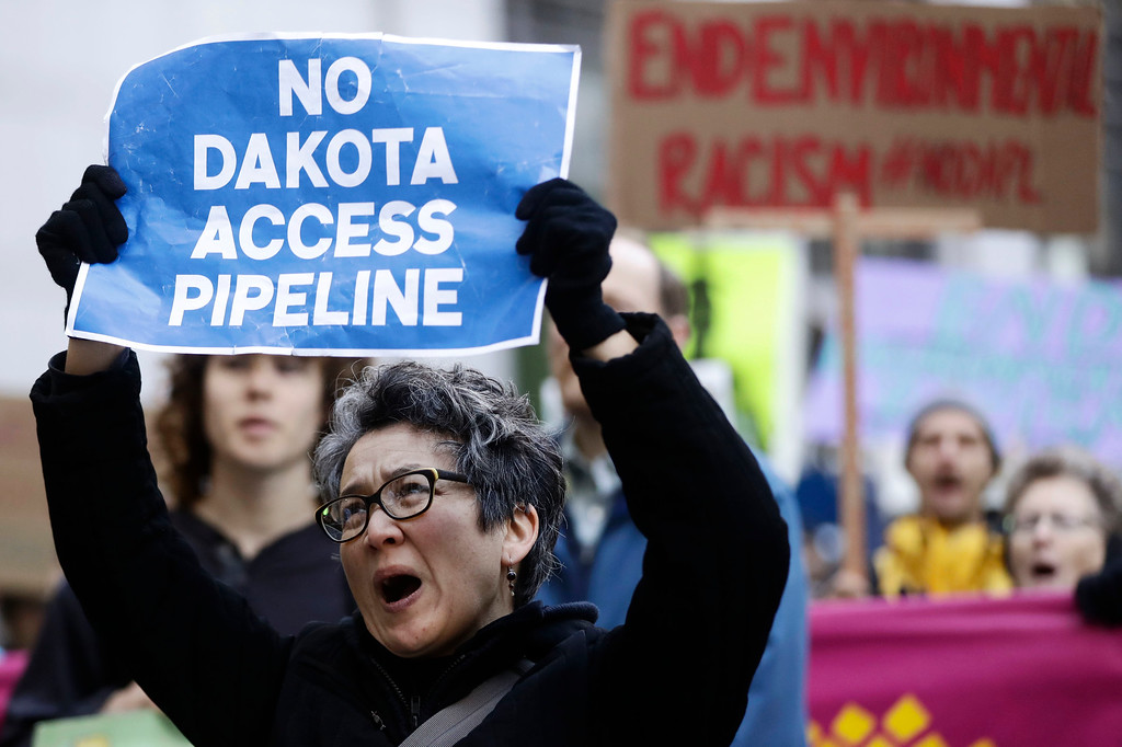 . Protesters demonstrate in solidarity with members of the Standing Rock Sioux tribe in North Dakota over the construction of the Dakota Access oil pipeline in Philadelphia, Thursday, Dec. 1, 2016. (AP Photo/Matt Rourke)
