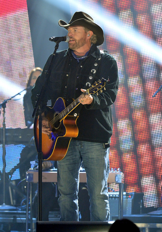 . Toby Keith performs onstage during the 2012 CMT Artists Of The Year at The Factory at Franklin on December 3, 2012 in Franklin, Tennessee.  (Photo by Rick Diamond/Getty Images for CMT)
