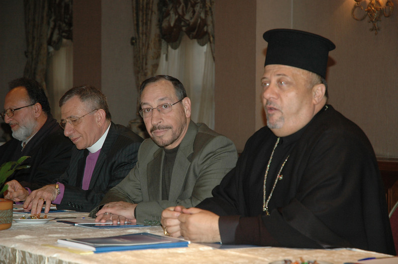 Father Nabil Haddad, Jordanian Intefaith Coexistence Research Center, right, addresses the ELCA bishops during a meeting in Amman Jan. 5.  To Haddad's right is Jordan's Minister of Islamic Affairs, Abdal Fatah Salah, and ELCJHL Bishop Munib Younan.