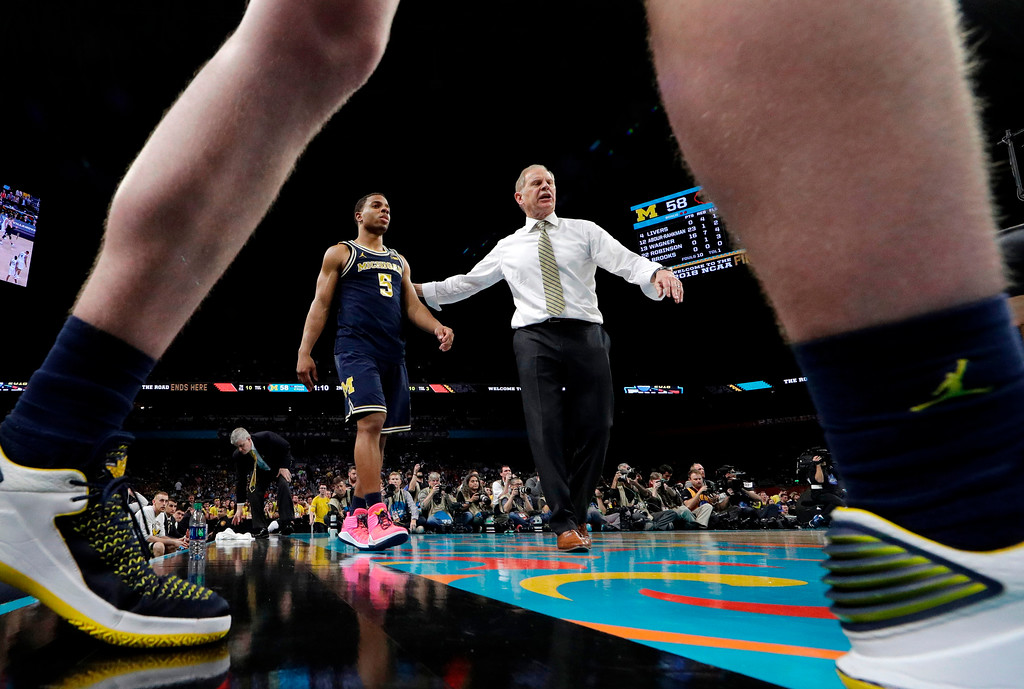 . Michigan head coach John Beilein talks with guard Jaaron Simmons (5) during the second half against Villanova in the championship game of the Final Four NCAA college basketball tournament, Monday, April 2, 2018, in San Antonio. Villanova won 79-62. (AP Photo/Eric Gay)