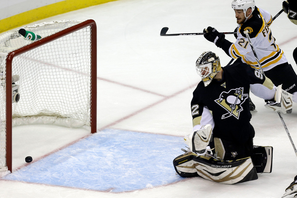. Pittsburgh Penguins goalie Tomas Vokoun (92) watches as a shot by Boston Bruins\' David Krejci  gets past him for a goal in the first period of Game 1 in an NHL hockey Stanley Cup Eastern Conference finals, Saturday, June 1, 2013, in Pittsburgh. (AP Photo/Gene J. Puskar)