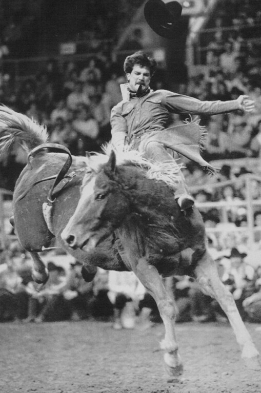 ". High-Flying Act -- Barry Copeland of Kersey, Colo., loses his hat as he tries to hold on to a horse named ""Jambalaya\"" during the bareback bronc riding competition at the National Western Stock Show and Rodeo Sunday afternoon at the Denver Coliseum. Rodeo riders from across the country and Canada are competing in the 83rd edition of the National Western through next Sunday. 1989 Credit: AP Laserphoto"