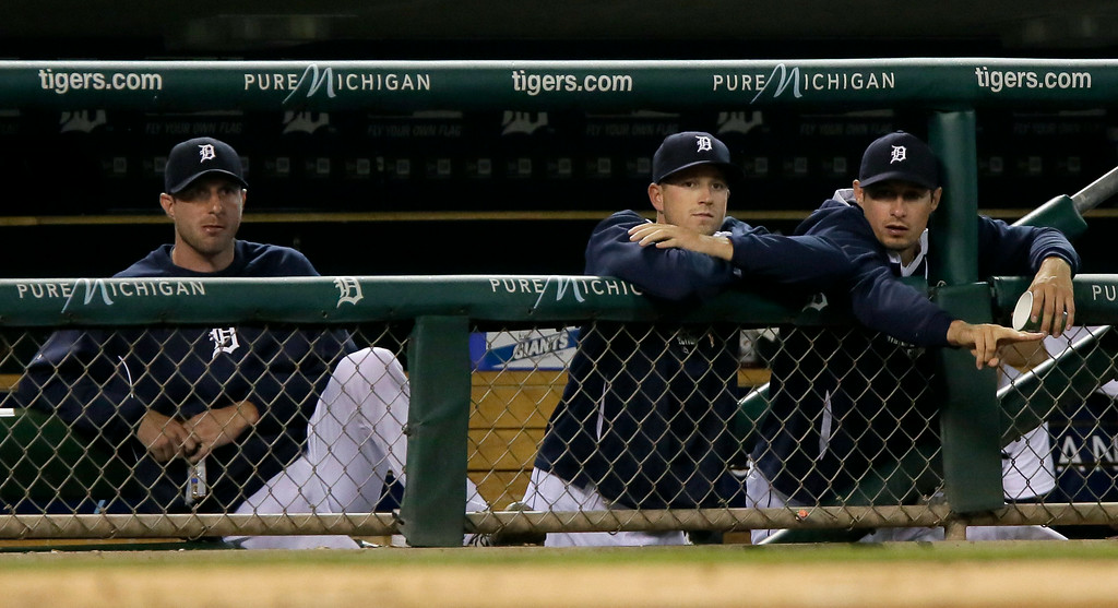 . Detroit Tigers pitcher Max Scherzer watches from the dugout with pitcher Drew Smyly and outfielder Don Kelly during the ninth inning of a 11-2 loss to the Chicago White Sox during a baseball game Tuesday, July 29, 2014, in Detroit. (AP Photo/Duane Burleson)