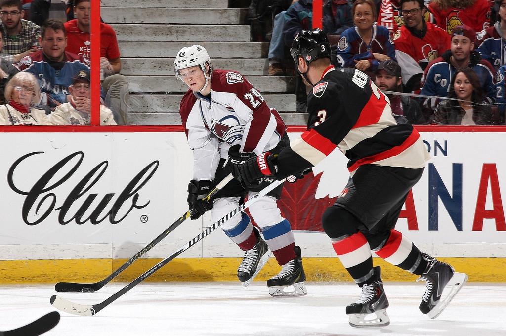 . Nathan MacKinnon #29 of the Colorado Avalanche skates with the puck against Marc Methot #3 of the Ottawa Senators during an NHL game at Canadian Tire Centre on March 16, 2014 in Ottawa, Ontario, Canada.  (Photo by Jana Chytilova/Freestyle Photography/Getty Images)