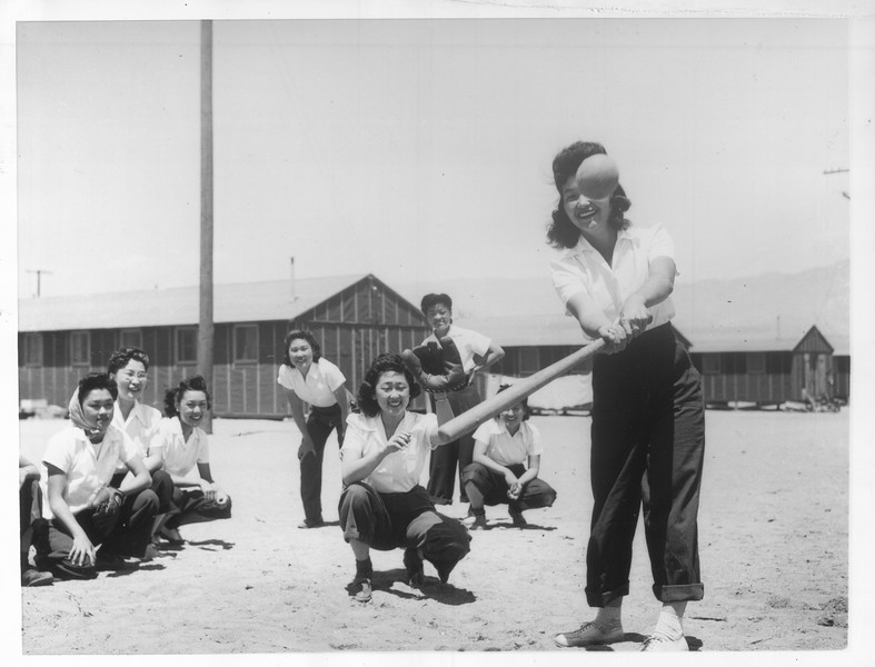 """""""Maye Noma behind the plate and Tomi Nagao at bat in a practice game between members of the Chick-a-dee soft ball team"""" -- caption on photograph"""