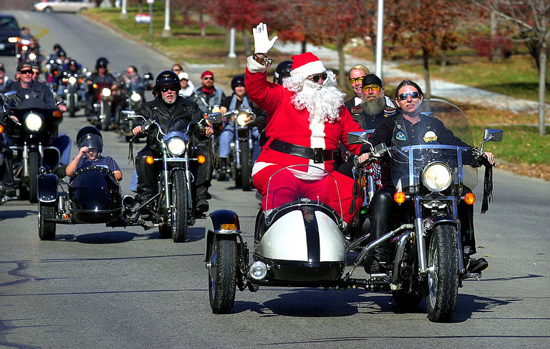. Santa Claus, portrayed by Dan Harman, is driven to the Noyes Home in St. Joseph, Mo., by Joyce Canfield on Sunday, Nov. 4, 2001. The Freedom of the Road Riders motorcycle club has been giving the children at the home a Christmas party on the first Sunday in November the past 20 years. The children get presents and a chance to look at and ride the motorcycles and to see Santa arrive in a motorcycle side car. The group drove through the city on the way to the children\'s home. (AP Photo/Ival Lawhon Jr.)