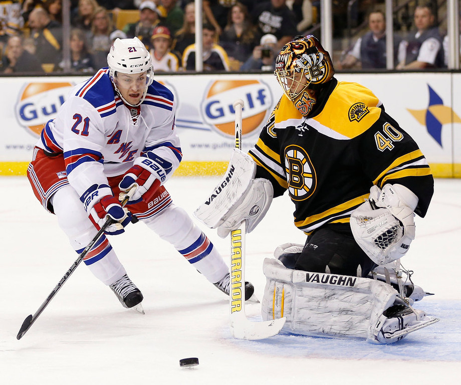 . New York Rangers\' Derek Stepan (21) skates for the rebound off Boston Bruins goalie Tuukka Rask (40), of Finland, during the first period of an NHL hockey game in Boston, Saturday, Jan. 19, 2013. (AP Photo/Michael Dwyer)