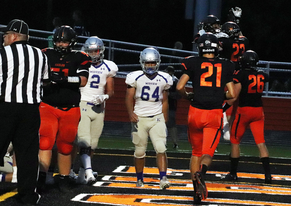 . Nicholas Pfeifer - The Morning Journal<br> North Olmsted celebrates a touchdown against Midview on Sept. 7.