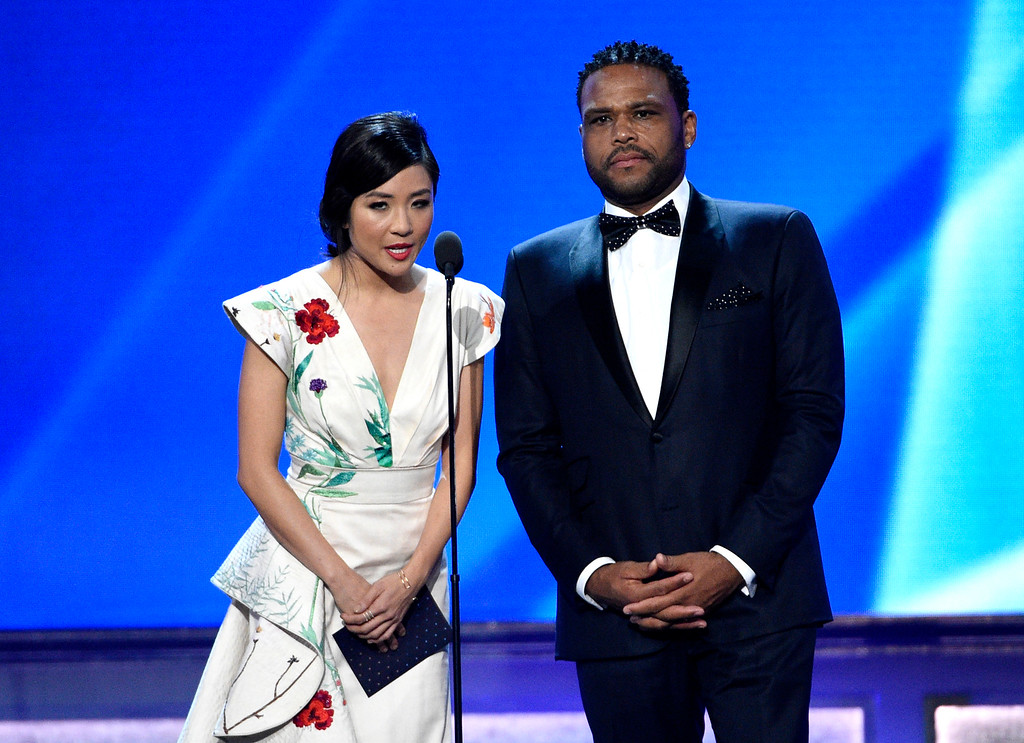 . Constance Wu, left, and Anthony Anderson present the award for best actor in a drama series at the 22nd annual Critics\' Choice Awards at the Barker Hangar on Sunday, Dec. 11, 2016, in Santa Monica, Calif. (Photo by Chris Pizzello/Invision/AP)