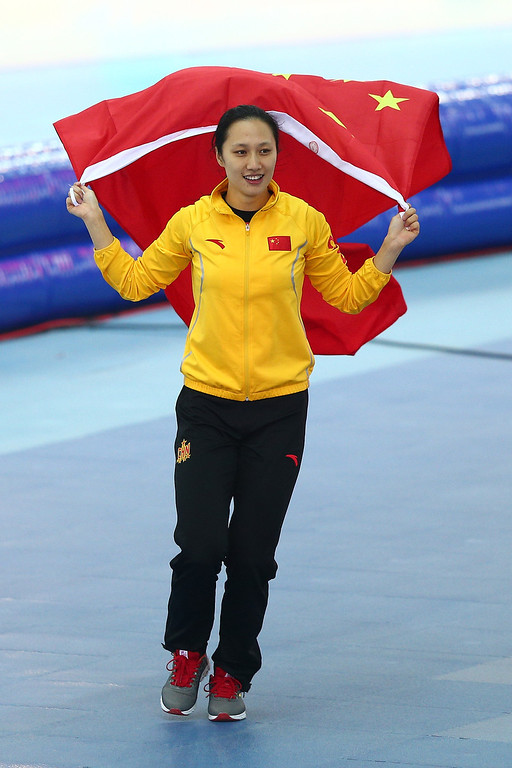 . Hong Zhang of China celebrates winning the gold medal during the Women\'s 1000m Speed Skating event on day 6 of the Sochi 2014 Winter Olympics at Adler Arena Skating Center on February 13, 2014 in Sochi, Russia.  (Photo by Clive Mason/Getty Images)