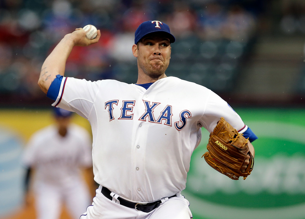 . Texas Rangers starting pitcher Colby Lewis (48) works against the Detroit Tigers in the first inning of a baseball game, Tuesday, June 24, 2014, in Arlington, Texas. (AP Photo/Tony Gutierrez)