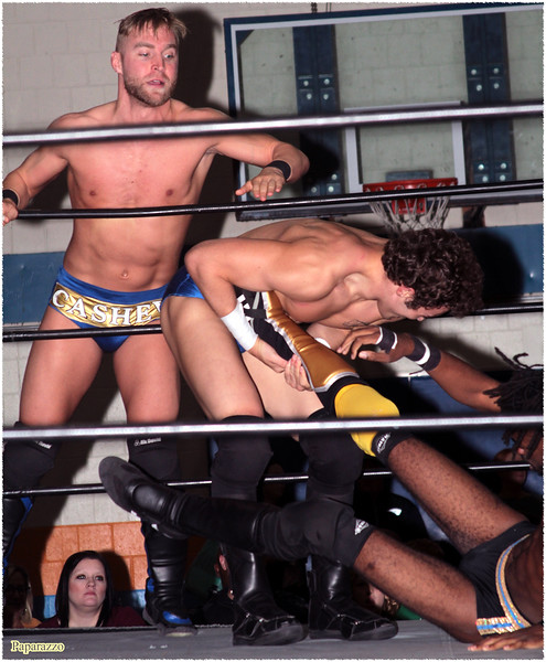 """Ricky Archer & Charlie Cashew vs. Xavier Faraday of Oreo Speedwagon during the UFO Wrestling """"Monsters Ball"""" show held on October 25, 2019 at the Tynan Community Center in South Boston, Massachusetts."""