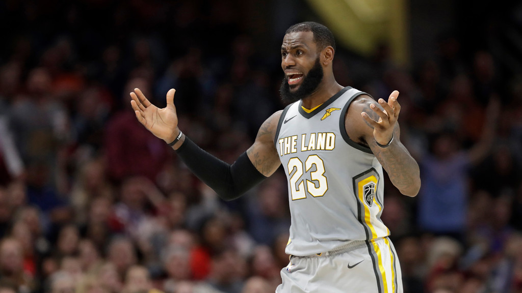 . Cleveland Cavaliers\' LeBron James complains to an official after getting called for a foul in the first half of an NBA basketball game against the Denver Nuggets, Saturday, March 3, 2018, in Cleveland. (AP Photo/Tony Dejak)