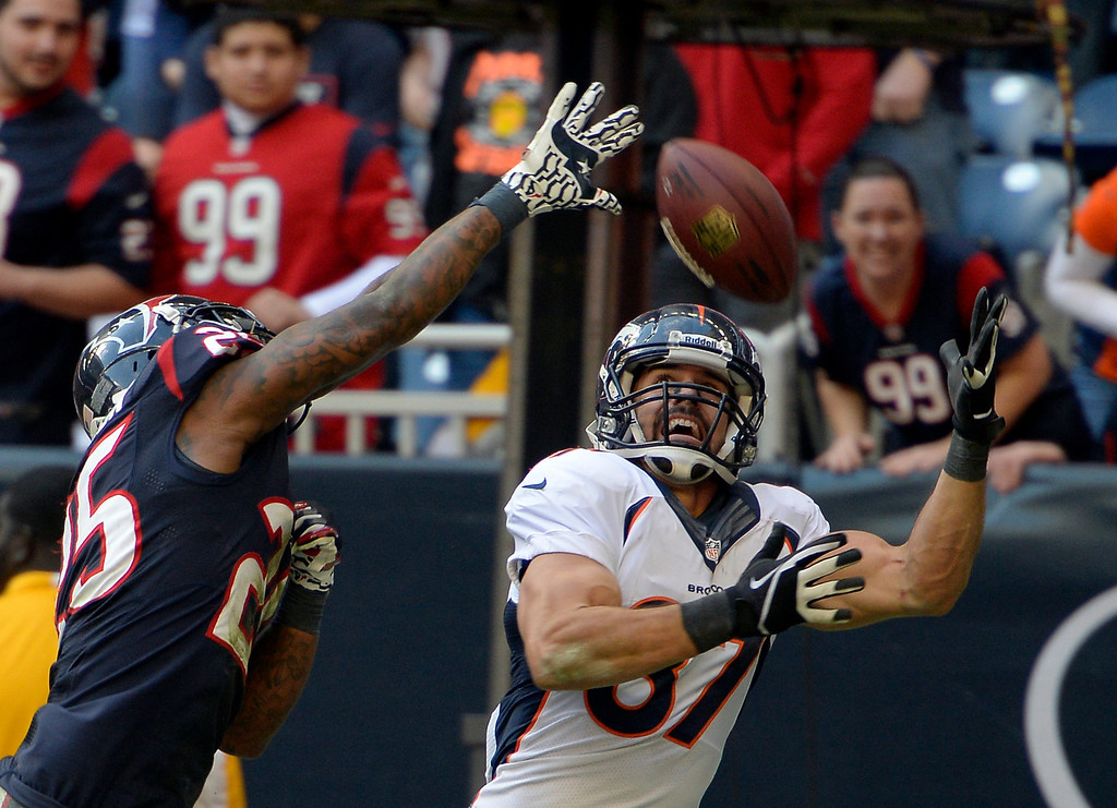 . HOUSTON, TX - DECEMBER 22: Denver Broncos wide receiver Eric Decker (87) catches his 10th touchdown of the year on Houston Texans cornerback Kareem Jackson (25) during the fourth quarter December 22, 2013 at Reliant Stadium. (Photo by John Leyba/The Denver Post)