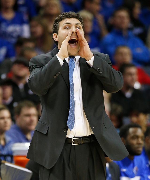 . Memphis coach Josh Pastner yells to his players during the first half of an NCAA college basketball game against Connecticut in the quarterfinals of the American Athletic Conference tournament Thursday, March 13, 2014, in Memphis, Tenn. (AP Photo/Mark Humphrey)